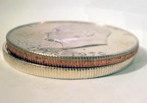 Copper-Nickel clad on top, Silver clad on bottom. Copper-nickel clad has the darker copper coloring; the silver clad has the bright, clean coloring.